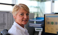 blonde woman at desk